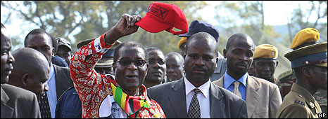"Zimbabwe""s President Robert Mugabe greets party supporters on his first rally in Shamva, Zimbabwe, 29 May"