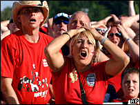 England fans watch the penalty shoot-out against Portugal at Euro 2004 on big screens