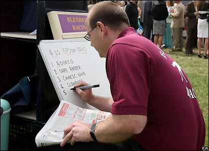A bookmaker prepares for a day's racing