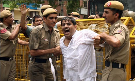 A BJP supporter protests against the oil price rise in Delhi