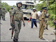 Sri Lankan soldiers stand guard at the site of an explosion in Moratuwa, outside Colombo, Sri Lanka, 6 June, 2008