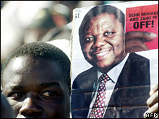 (MDC) supporter holds a placard at a Bulawayo rally 18 May