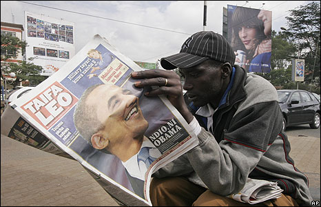 A Kenyan man read a newspaper about U.S. Democratic presidential hopeful Barack Obama, Thursday, June 5, 2008 in Nairobi, Kenya. The newspaper headline reads Yes Obama.