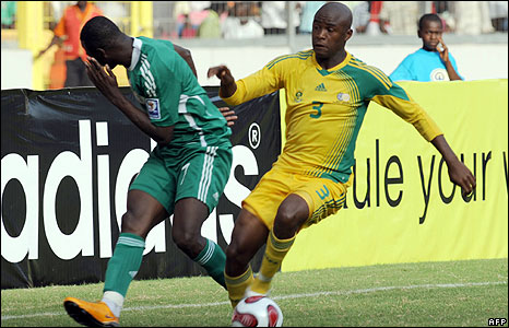 South African Tsepo Masilea (R) collects the ball after hitting the face of Nigerian attacker John Utaka during FIFA 2010 World Cup and Africa Cup of Nations qualifying match in Abuja on Sunday