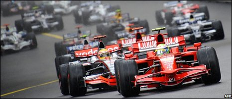 "Felipe Massa drives ahead of McLaren Mercedes"" British driver Lewis Hamilton at the Monaco racetrack on May 25, 2008"