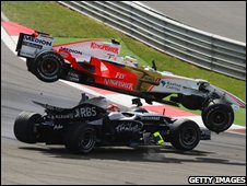 Giancarlo Fisichella (top) of Italy and Force India and Kazuki Nakajima (bottom) of Japan and Williams collide