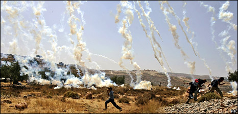 Protesters dodge tear-gas canisters in Bilin (6 June 2008)