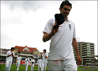 James Anderson leads England off the field after his figures of 6-42