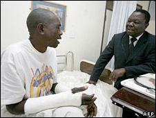 Morgan Tsvangirai visits an MDC supporter injured in post-election violence