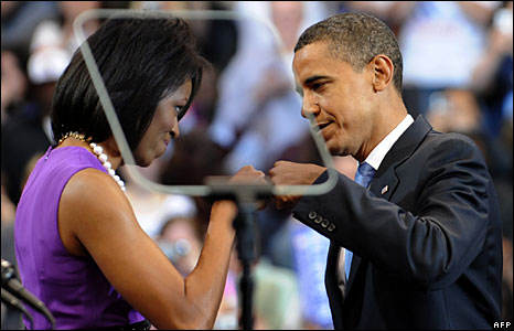 "Michelle Obama ""fistbumps"" husband Barack as they celebrate his clinching the Democratic presidential nomination at a rally in St Paul, Minnesota, 3 June 2008"