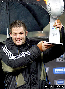 All Blacks captain Richie McCaw lifts the trophy to mark his team's win