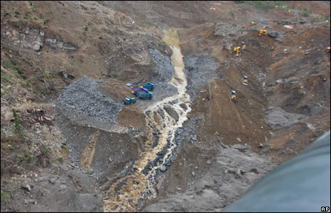 Water from the Tangjiashan lake flows down a landslide site in Mianyang City (7/6/08)