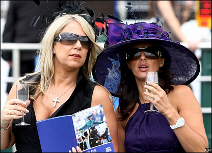 Racegoers study the form at Epsom