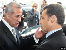 French President Nicolas Sarkozy (R) is greeted by his Lebanese counterpart Michel Suleiman
