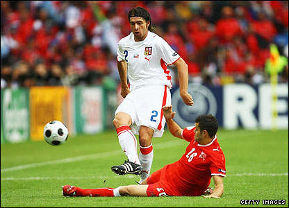 Zdenek Grygera is tackled by Switzerland's Tranquillo Barnetta