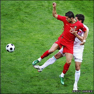 Cristiano Ronaldo is shadowed by Hakan Balta
