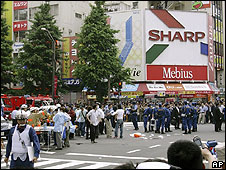 Crowds at scene of stabbing, Akihabara, Japan