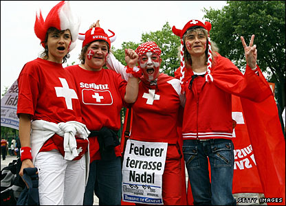 Swiss supporters prepare to get behind Roger Federer ahead of the men's final