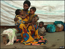 A mother sits with her children in a camp for displaced people in Kinyandonyi, DR Congo