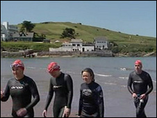 Swimmers at the end of the swim around Burgh Island