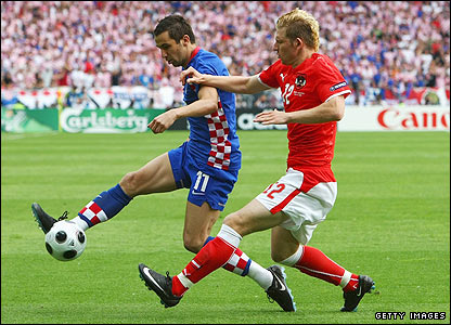 Croatian midfielder Darijo Srna shields the ball from Ronald Gercaliu