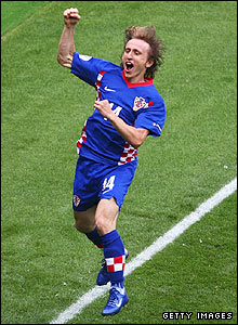 Luka Modric celebrates scoring his penalty