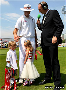 Michael Vaughan is interviewed by Jonathan Agnew while Vaughan's children look after the trophy