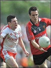 Sean Cavanagh of Tyrone in action against Down's Dan Gordon