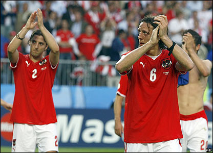 Austria's players applaud their fans