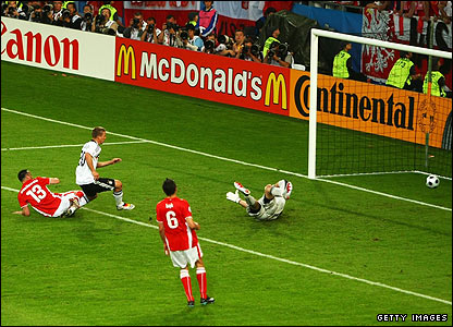 Lukas Podolski slots home Miroslav Klose's pass to put Germany ahead