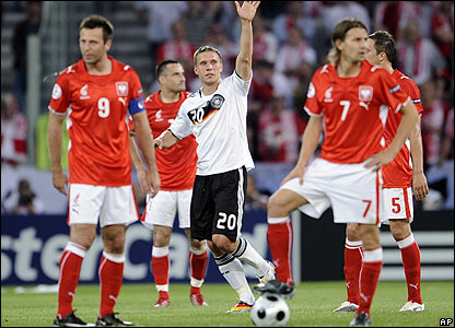 Podolski celebrates scoring his second