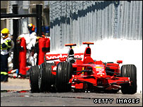Kimi Raikkonen's Ferrari and Lewis Hamilton's McLaren stranded after the crash