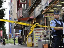 Police work in a cordoned off area in Akihabara on 8 June 2008