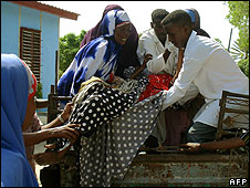 A woman wounded in an artillery battle is taken to Medina Hospital in Mogadishu on June 8, 2008
