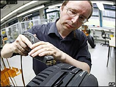 Man works on tyre at German firm Continental