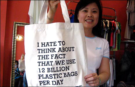 Ms Tian woman holds up one of the new cloth bags