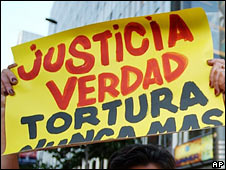 Chilean protester holds a placard calling for justice, truth and an end to torture (file image, 2004)