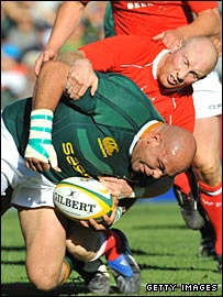 Springbok star Gurthro Steenkamp is hauled down by Tom Shanklin during the first Test