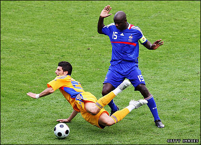 Daniel Niculae is tackled by French defender Lilian Thuram
