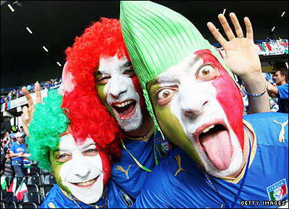Italian fans create a riot of colour in the Stade de Suisse Wankdorf