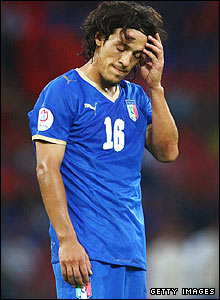 Mauro Camoranesi of Italy looks dejected