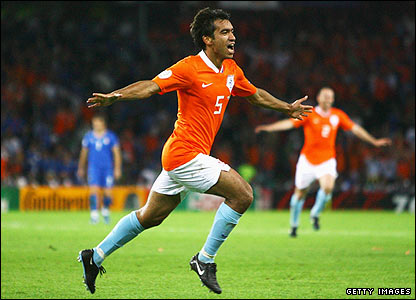 Van Bronckhorst's header is celebrated wildly