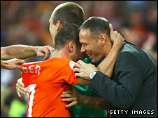 Coach Marco van Basten celebrates Sneijder's goal with the player