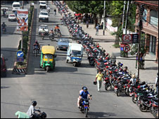A queue of motorcycles outside a petrol station in Kathmandu