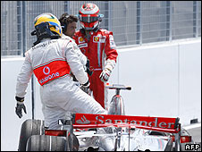 Lewis Hamilton climbs out of his car to face Kimi Raikkonen after crashing into the back of the Ferrari driver in the pit lane in Canada