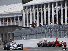 Robert Kubica's BMW Sauber passes the stranded cars of Kimi Raikkonen and Lewis Hamilton on his way to victory in the Canadian Grand Prix