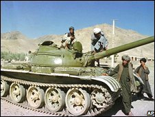Taliban fighters by tank