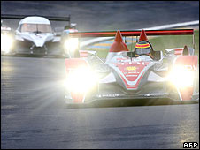 Audi's Frank Biela leads a Peugeot during last month's Le Mans test day