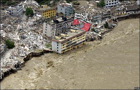 Flood waters reach damaged city