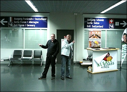 Stuart, Tam and the airport signs
